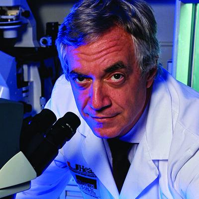 Camillo Ricordi with Microscope cropped1 (1)